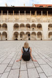 Female traveler on the background of Arcades in Wawel Castle in Cracow. Poland. Renaissance Stock Photography