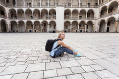 Female traveler on the background of Arcades in Wawel Castle in Cracow. Poland. Renaissance Stock Photo