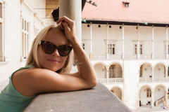 Female traveler on the background of Arcades in Wawel Castle in Cracow. Poland. Renaissance Royalty Free Stock Photos
