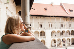 Female traveler on the background of Arcades in Wawel Castle in Cracow. Poland. Renaissance Royalty Free Stock Photo