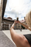 Female traveler on the background of Arcades in Wawel Castle in Cracow. A woman in a blue T-shirt with a backpack on her back is standing in the courtyard of Royalty Free Stock Photography