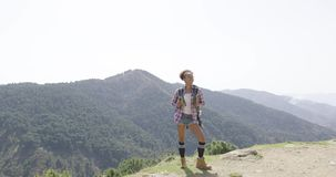 Female traveler backpacking in summer stock video footage