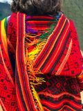 Female traveler dressed in colorful Peruvian poncho in Machu Picchu, one of the New Seven Wonder of The World, Cusco Region,. Female traveler dressed in stock image