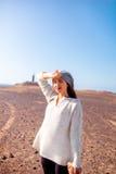 Female traveler feeling tired in the desert Royalty Free Stock Image