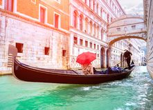 Female traveler in Gondola passing over Bridge of Sighs in Venice Royalty Free Stock Photos