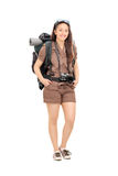 Female traveler with hiking equipment Royalty Free Stock Photography