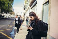 Female traveler holding and reading tourist map. Waiting the tram,using public transportation in foreign country.Tourist in Lisbon,Portugal awaiting iconic royalty free stock photos
