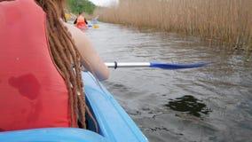 Female traveler on the kayak. Girl with paddle and kayak swim on big river, traveler on canoe stock video footage