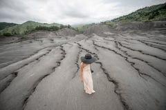 Female traveler near mud volcanoes Royalty Free Stock Photos