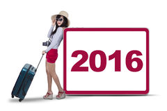 Female traveler with number 2016 in studio Royalty Free Stock Image