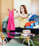 Female traveler and packing suitcase Stock Photos