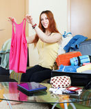 Female traveler packing suitcase Royalty Free Stock Image