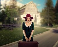 Female traveler in retro hat and dress Stock Photography