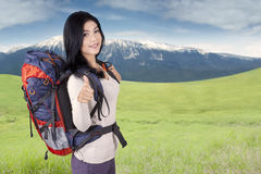 Female traveler showing thumb up on the hill Stock Image