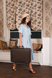 Female traveler standing in the room with luggage. Stock Photo