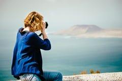 Female traveler taking a photo Royalty Free Stock Photos