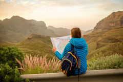 Female traveler with tourist map Stock Photos