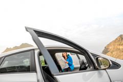 Female traveler with toursit map near the car Stock Image
