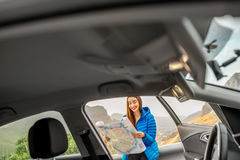 Female traveler with toursit map near the car Royalty Free Stock Photos