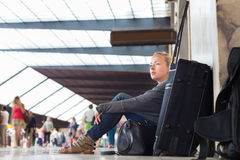 Female traveler waiting for departure. Stock Photos