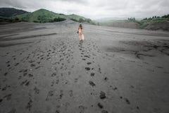 Female traveler walking near mud volcanoes Stock Photography