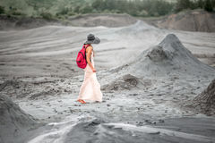 Female traveler walking near mud volcanoes Stock Photos