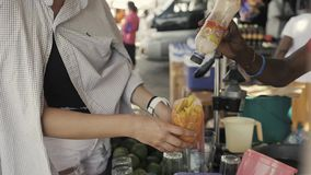 Female traveler woman buying fresh tropical mango fruit with pepper on traditional street food market in asia. Female traveler woman buying fresh tropical fruit stock video