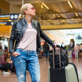 Female traveller checking flight departures board. Stock Photography