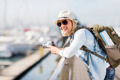 Female traveller harbour. Gorgeous young female traveller at the harbour Royalty Free Stock Images