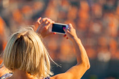 Female traveller make a photo of Dubrovnik to the phone. Stock Photo