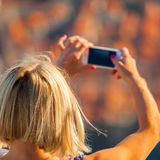 Female traveller make a photo of Dubrovnik to the phone. Stock Photography