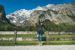 Female traveller posing in front of mountain view of Alps Royalty Free Stock Photography