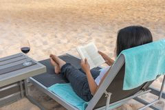 Female traveller reading books on the beach royalty free stock photography