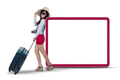 Female traveller with signboard Stock Photos
