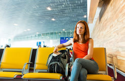 Female traveller sitting with ticket in her hands. stock image