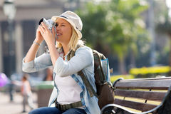 Female traveller taking photos Stock Images
