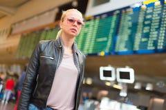 Female traveller walking airport terminal. Stock Images