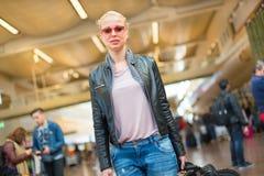 Female traveller walking airport terminal. Royalty Free Stock Images