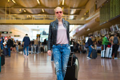 Female traveller walking airport terminal. Stock Photos