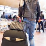 Female traveller walking airport terminal. Stock Image