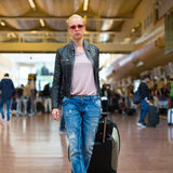 Female traveller walking airport terminal. Royalty Free Stock Photos
