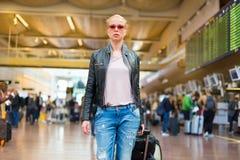 Female traveller walking airport terminal. Royalty Free Stock Image