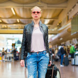 Female traveller walking airport terminal. Royalty Free Stock Image