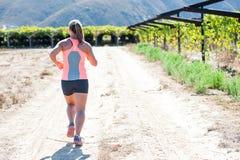 Female triathlete running Stock Photography