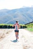 Female triathlete running Stock Images