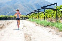 Female triathlete running Royalty Free Stock Photography