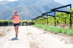 Female triathlete running Stock Photo