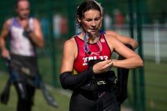 Female triathlete in the traffic. Royalty Free Stock Photos