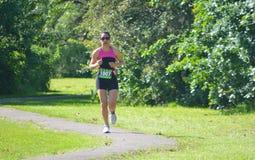 Female Triathlon runner in park Stock Photography