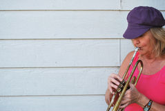 Female trumpet player. Royalty Free Stock Photography